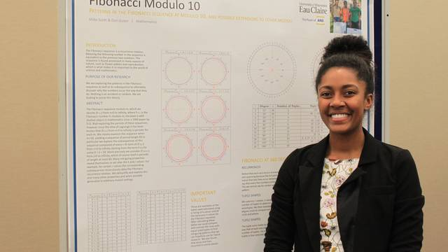 Miko Scott with Research Poster