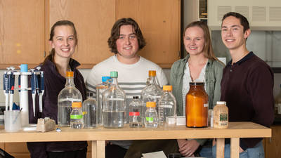 Moss research team members in the biology lab
