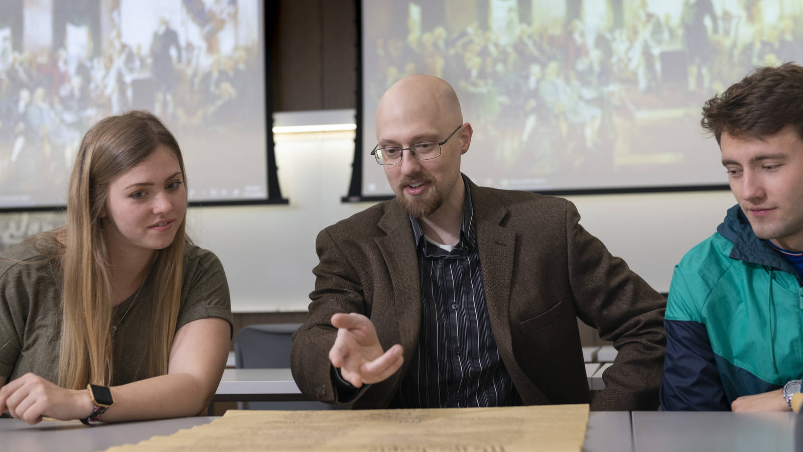 Blugolds Makenna Goretski (left) and Zach Janssen (right) are studying current political events in classes that focus on the U.S. Constitution, which are taught by Dr. Eric Kasper (center).