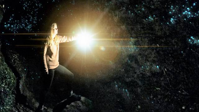UW-Eau Claire student Julia Wopat explores a glowworm cave in New Zealand