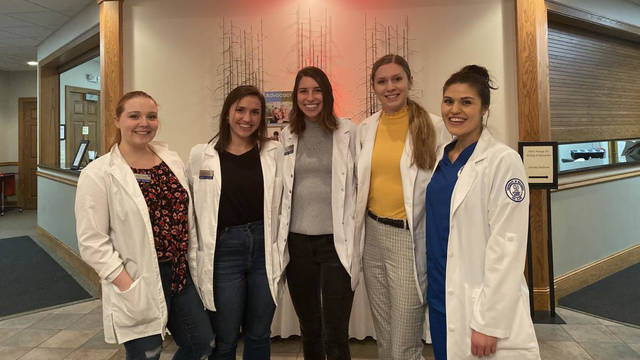 UW-Eau Claire nursing students (from left) Morgan Karasek, Alexandra Tupy, Elizabeth Moran, Amanda Koenig and Jessica Johnson recently provided hand massages to local community caregivers.