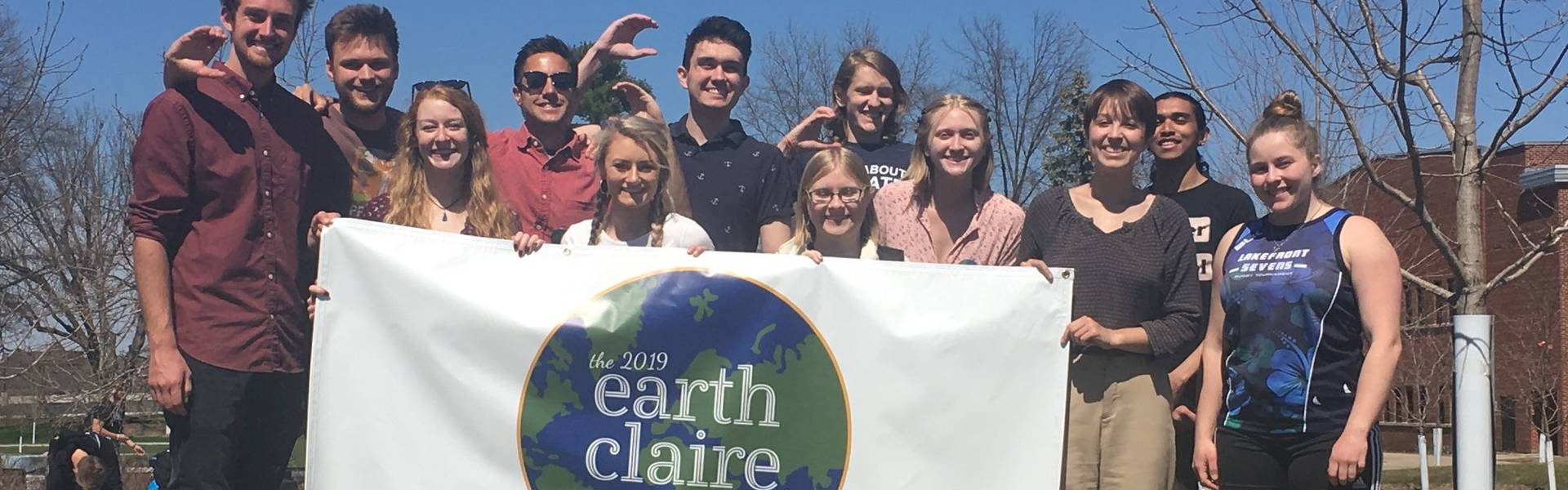 Students holding up a banner for Earth Claire 2019