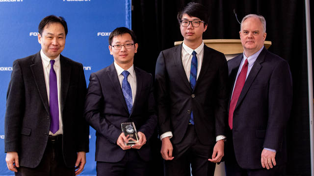Dr. Wufeng Tian (second from left) and Huoyu Xu (third from left), along with FoxConn representatives at the Smart Cities-Smart Futures Competition. Xu is the student representative for the grand-prize team that created the B.E.S.T. Sign project.