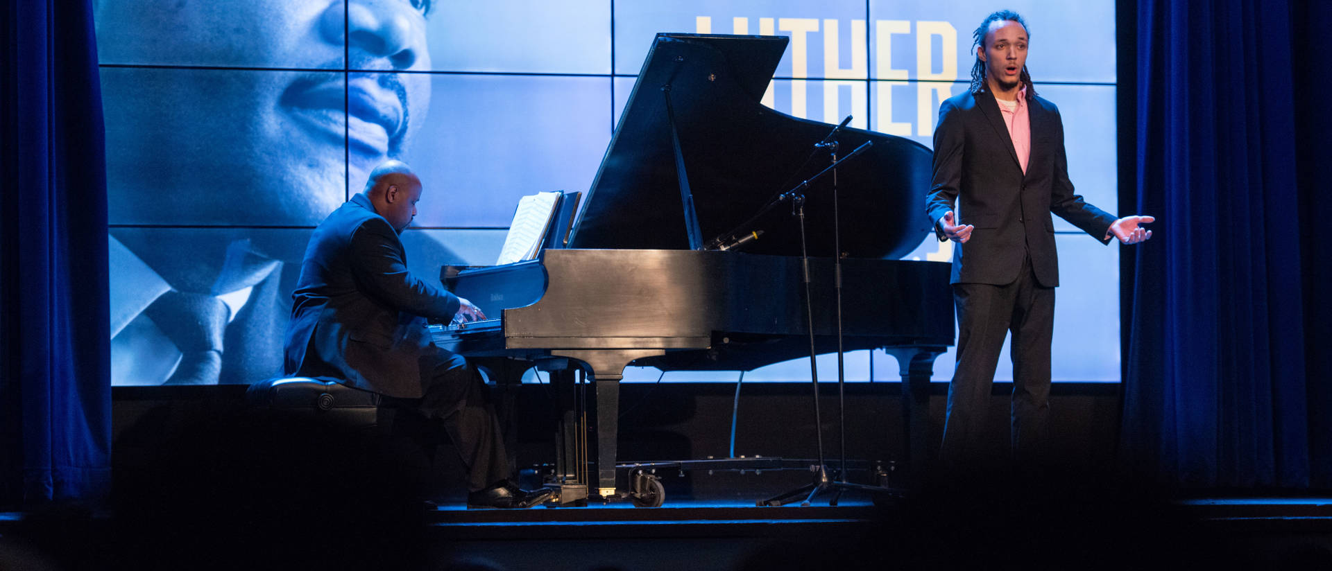 UW-Eau Claire student Elijah Vanderpoel performs a vocal solo at the 2019 Martin Luther King Jr. Celebration, with Dr. Frank Watkins, assistant professor of music, providing piano accompaniment.