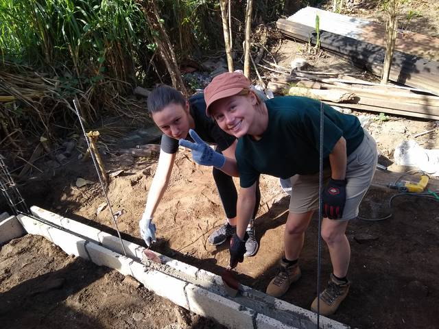 Emma Barnd (left) and Tabetha Stevens work on a service-learning project during their Winterim immersion in Guatemala.