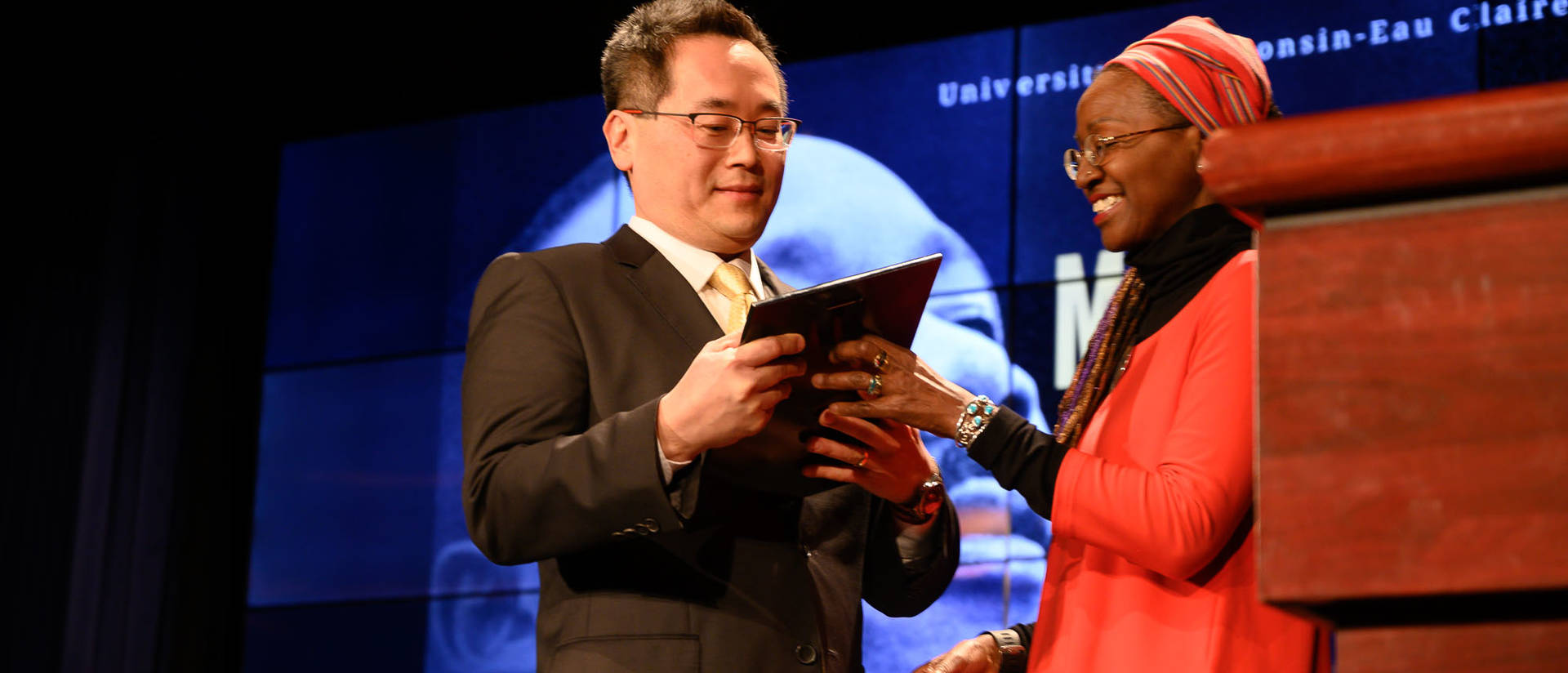 David Shih receives the MLK Social Justice Leadership Award on Feb. 5 from last year's recipient, Dr. Rose MArie Avin
