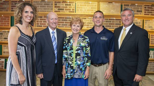 John and Carolyn Sonnentag with Blugold basketball coaches and athletic director