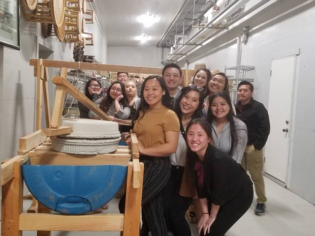 Blugolds were excited to see a traditional Hmong grinding artifact while visiting the Hmong Cultural Heritage Center & Museum. The traditional Hmong grinding artifact is typically used to grind rice or corn.