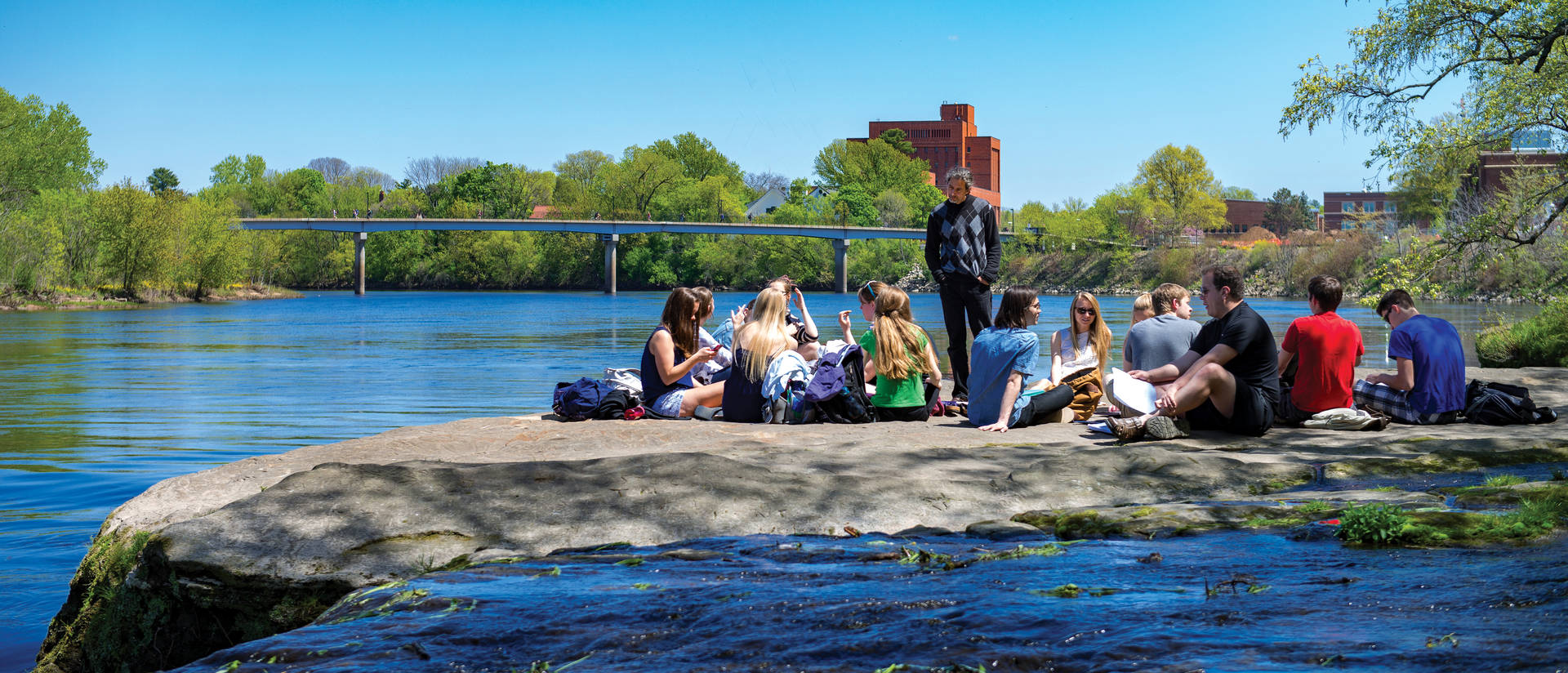 Students attending class outside on Putnam Rock