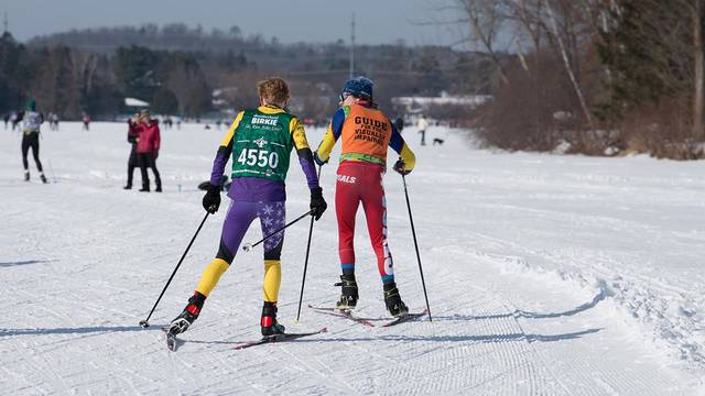 Wyatt Pajtash guiding visually impaired during a race