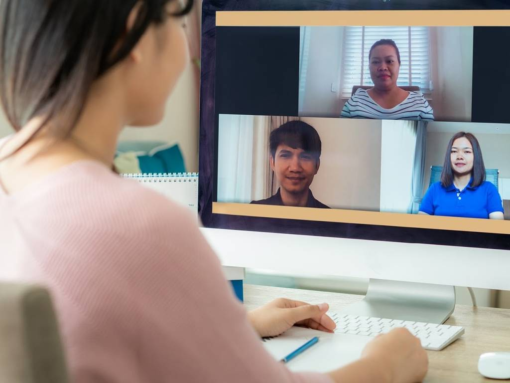 woman videoconferencing with three people