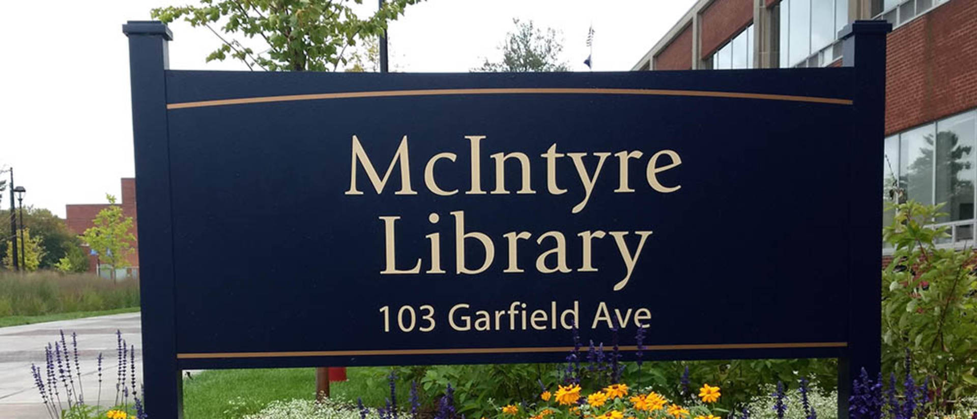 Flowers around McIntyre Library sign