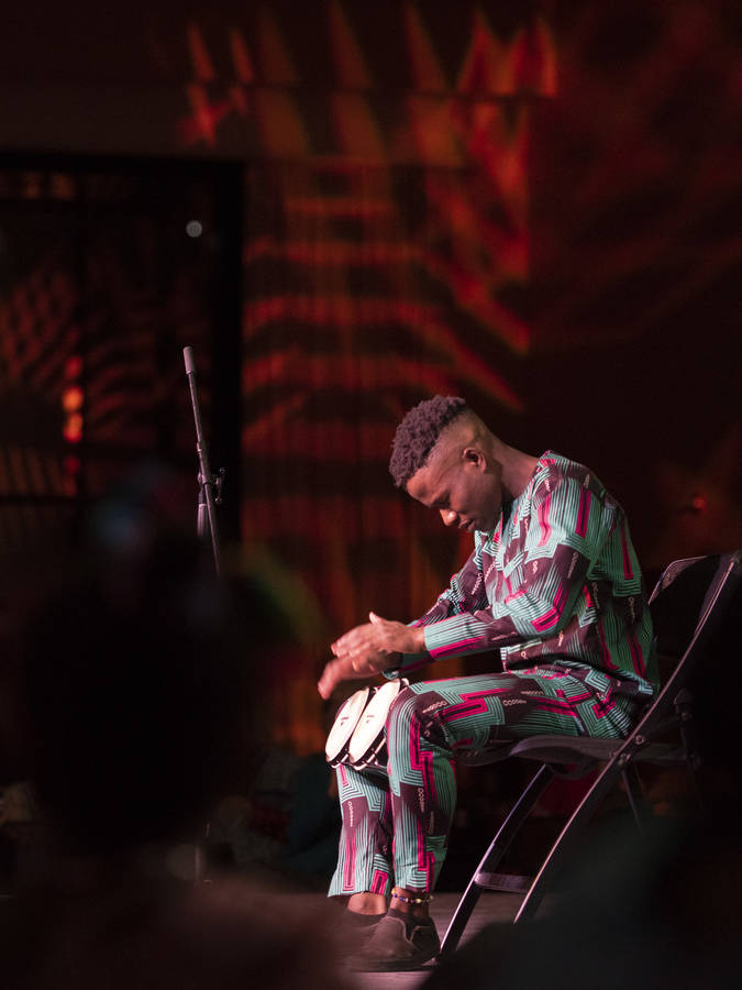Drum player on a stage, African drums