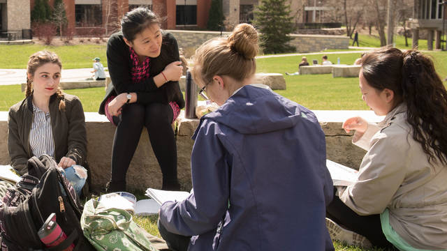 Dr. Kaishan Kong teaching class outdoors at UW-Eau Claire