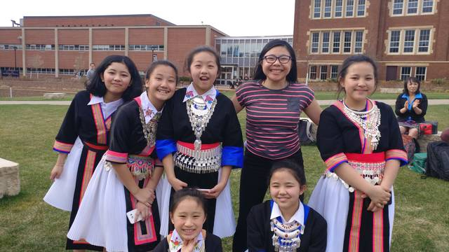Gaoki Lee and Delong Middle School Hmong dancers on campus mall