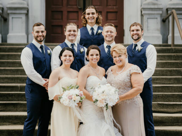 Six of the seven Burzynski siblings are Blugolds. Front row, left to right: Jen, Julie and Jane (mother); Middle row: Scott, Austin, Greg and Brad; Back row: Sam.