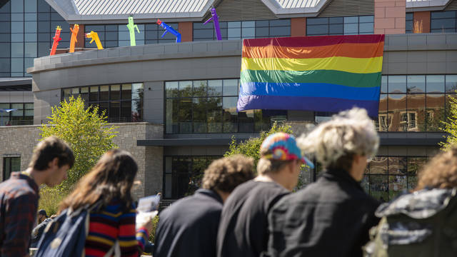 Pride flag on Davies Center facing campus mall
