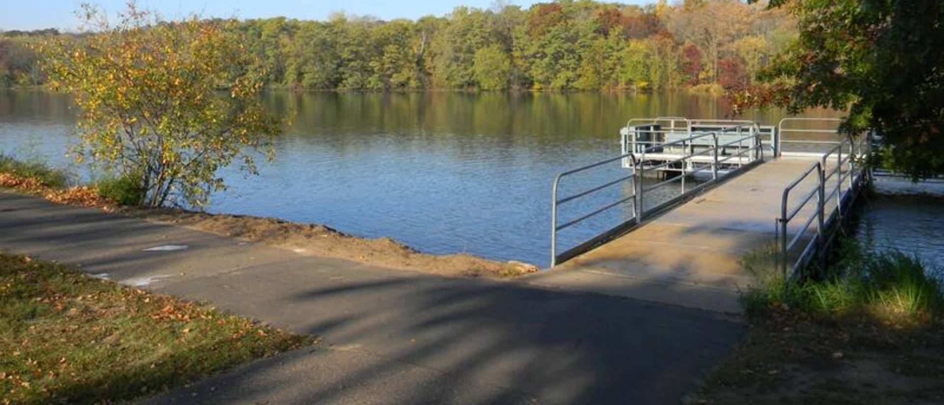 "This image, part of McIntyre Library's ""ADA30: Accessibility in the Chippewa Valley"" online exhibit, depicts the Braun's Bay accessible boat launch into Half Moon Lake in Eau Claire."