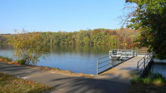"""This image, part of McIntyre Library's """"ADA30: Accessibility in the Chippewa Valley"""" online exhibit, depicts the Braun's Bay accessible boat launch into Half Moon Lake in Eau Claire."""