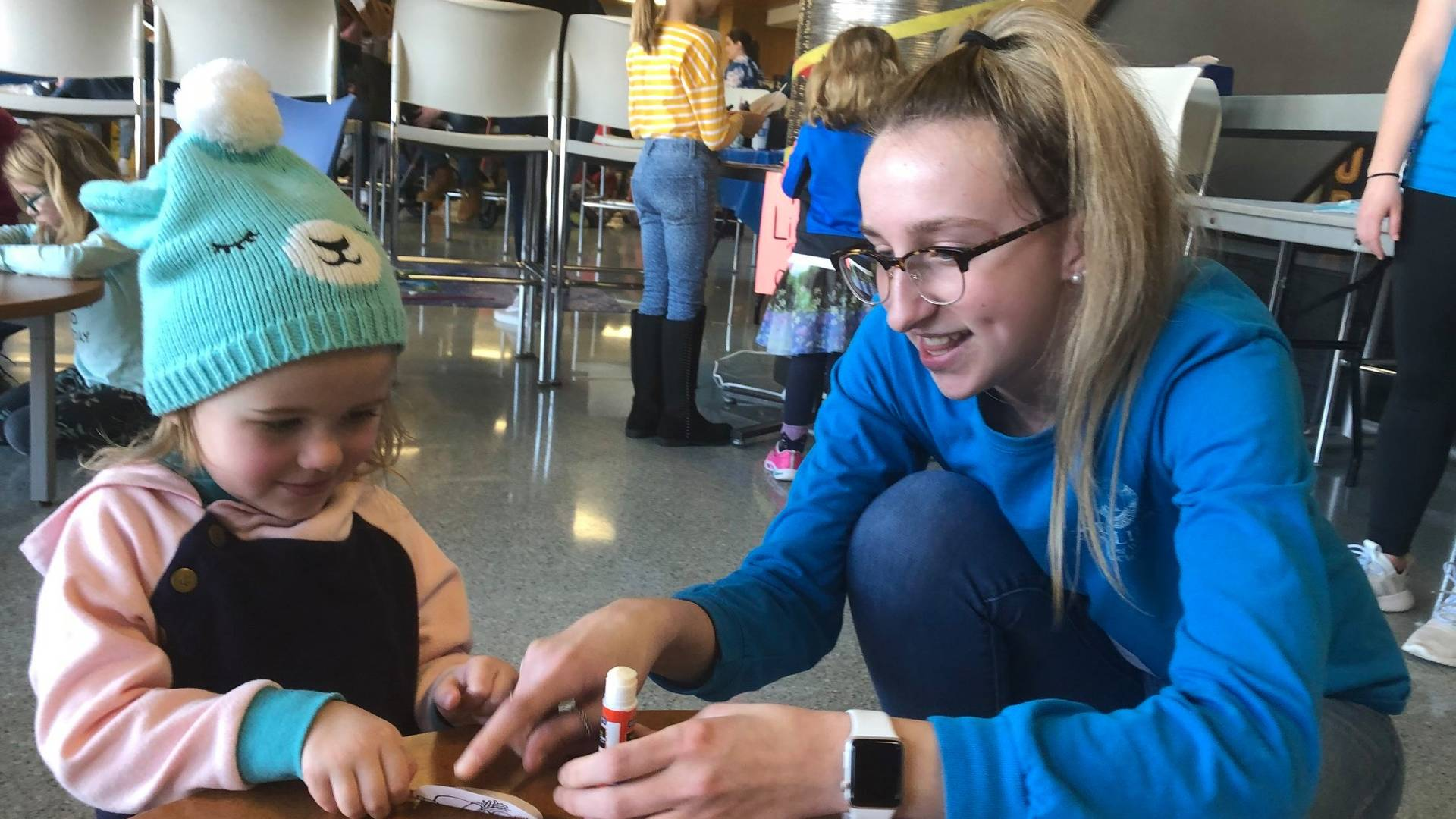 UW-Eau Claire student Allison Mulroy works with a child during an ECLIPSE session.