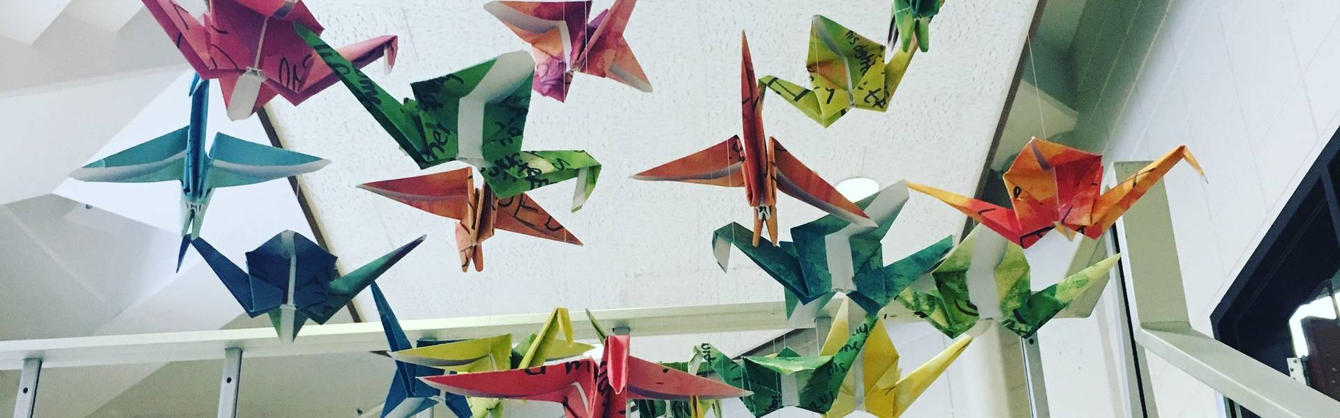 Flock of origami birds in stairwell