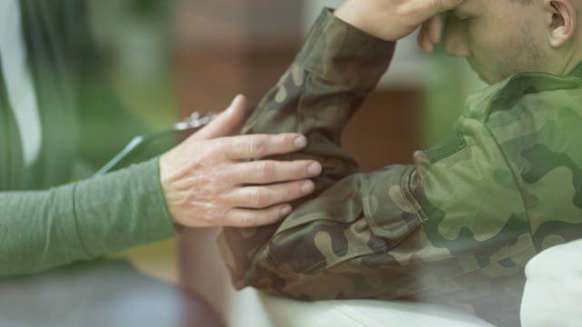 person consoling a military person