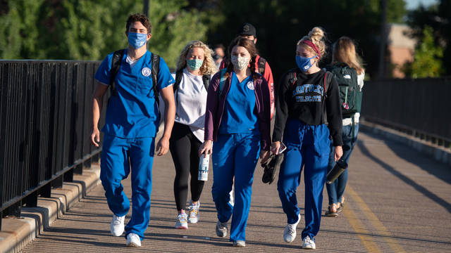 Nursing students walking across bridge during pandemic