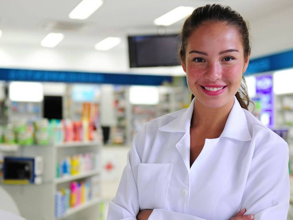 Young women standing in a pharmacy wearing a pharmacy coat.