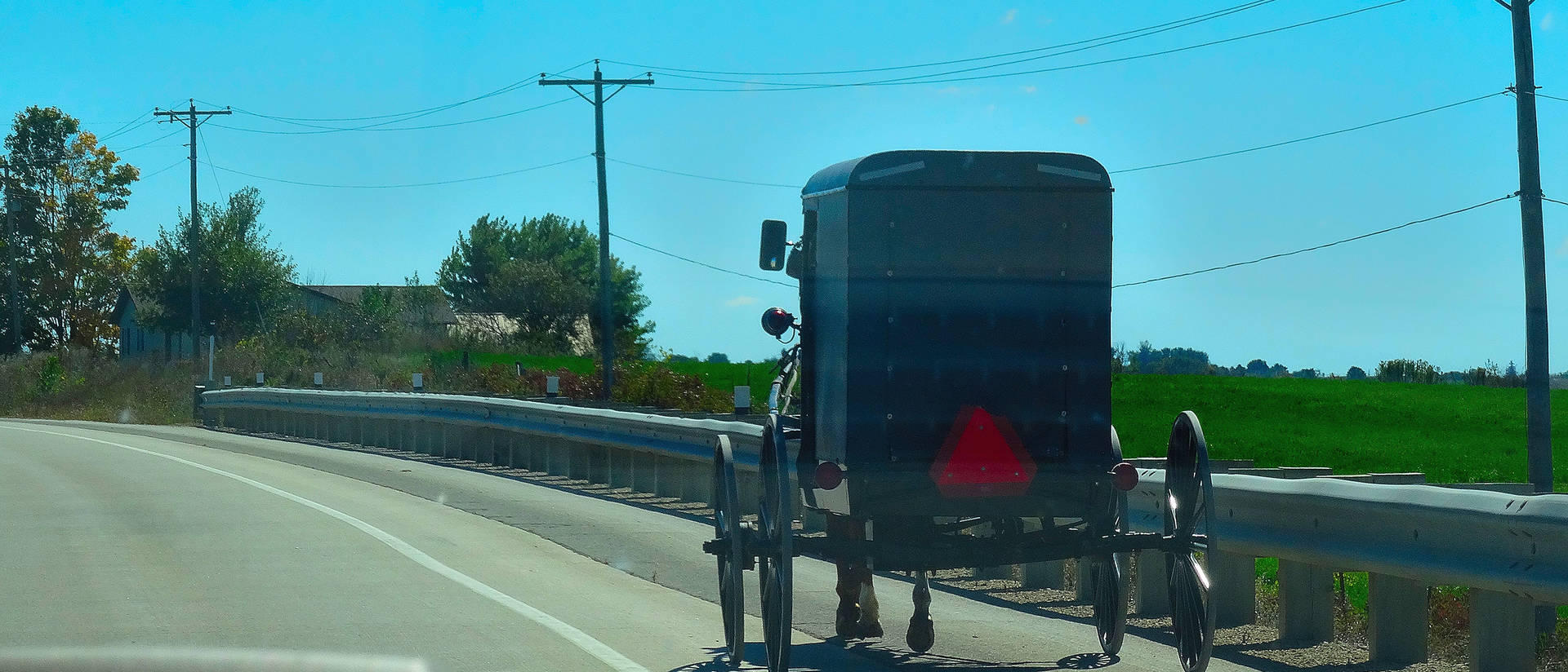 An Amish buggy travels on U.S. Highway 61. (Photo credit: Corey Coyle, Wikimedia Commons)