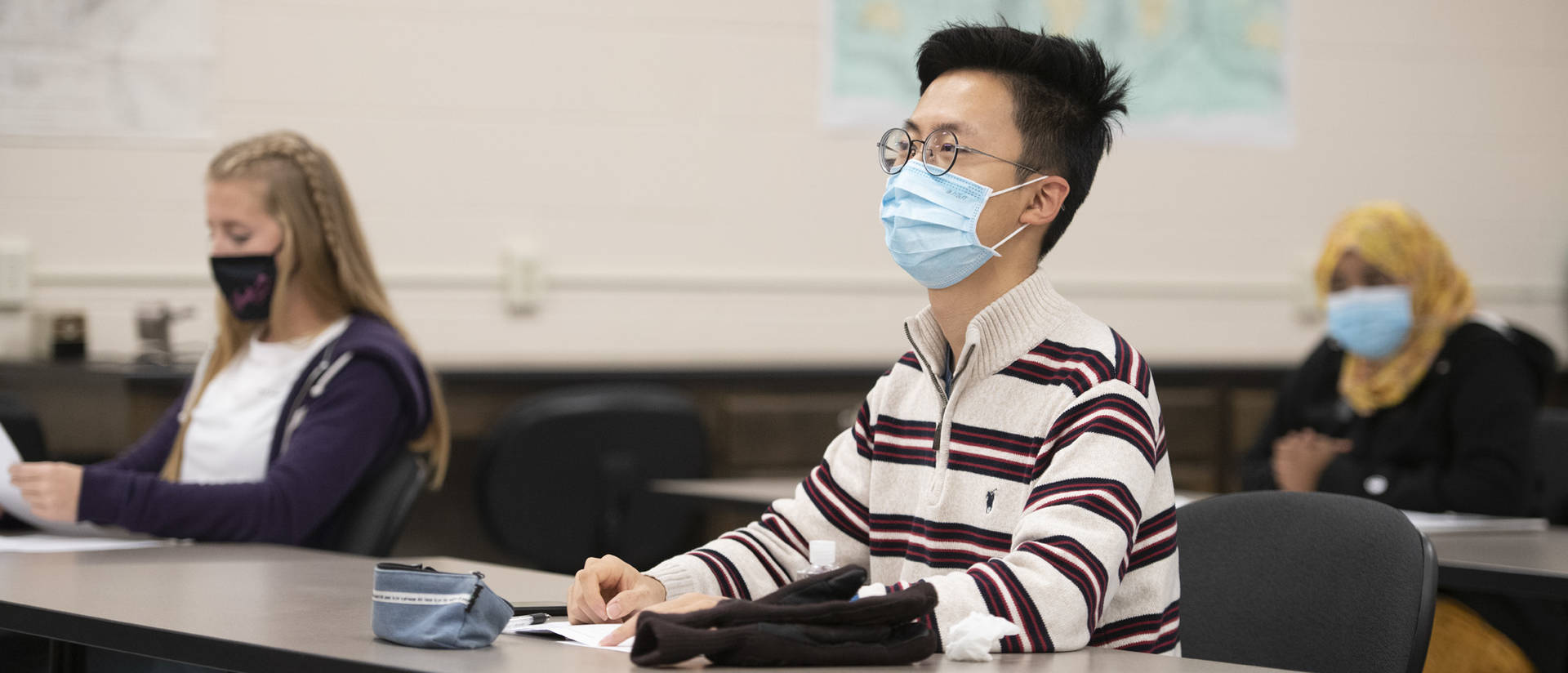 Student in mask engaged in class