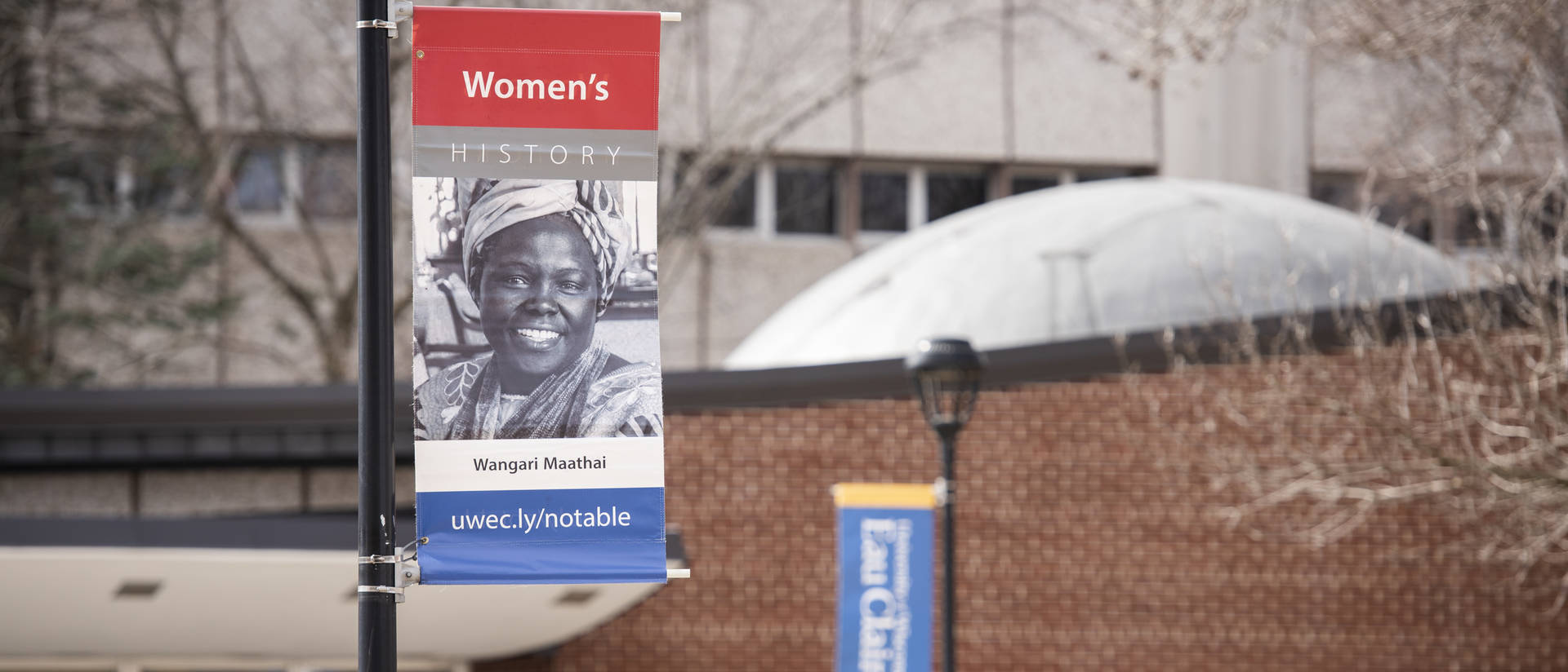 Women's History Month banner outside on campus mall