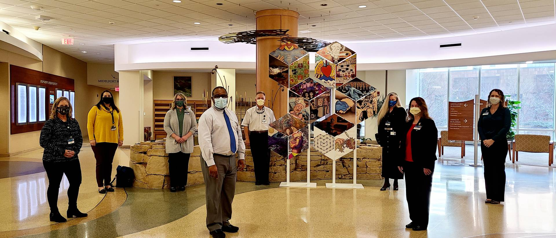 Mayo Clinic Health System staff with the initial installation of the Healing Reflections art gallery