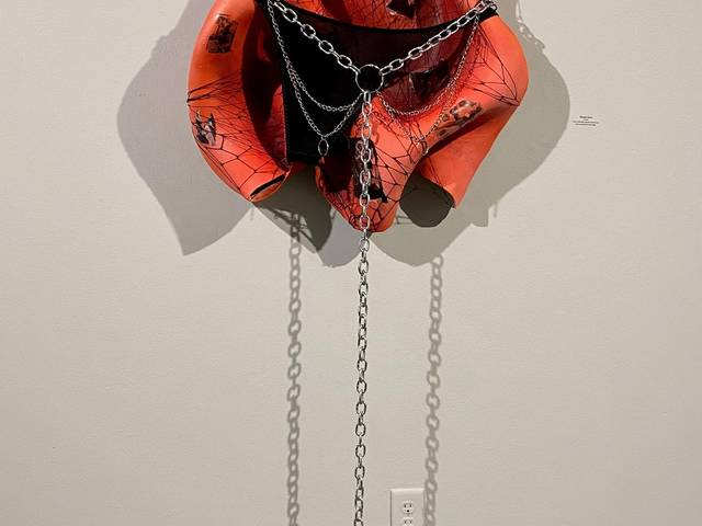 Sculptural painting with chains and panties