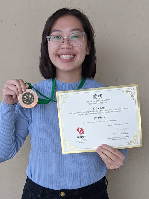 Woman holding certificate