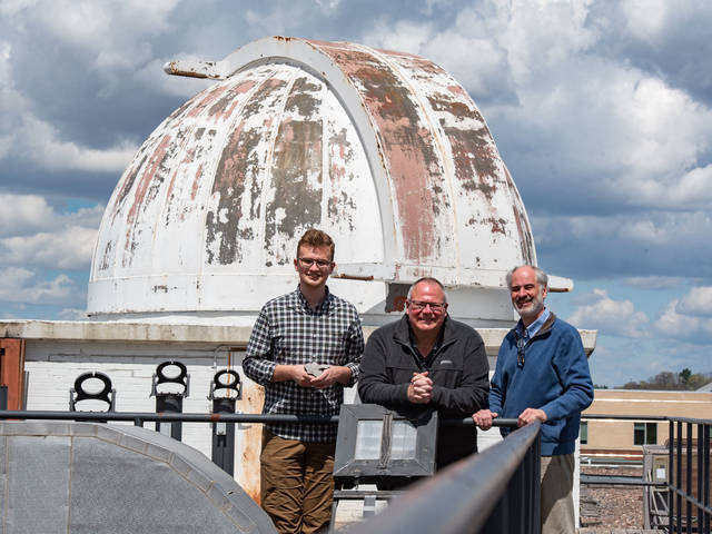 Tyler Gonzales, Paul THomas and Phil Ihinger on Phillips rooftop