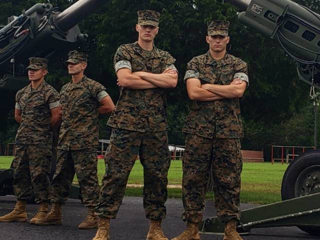 Eau Claire native Chad Schultz (left) graduated from the Marine Corps' Officer Candidate School after completing the program during two summers.