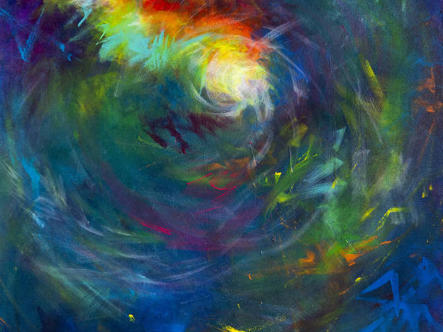 Colorful swirls of paint on a canvas