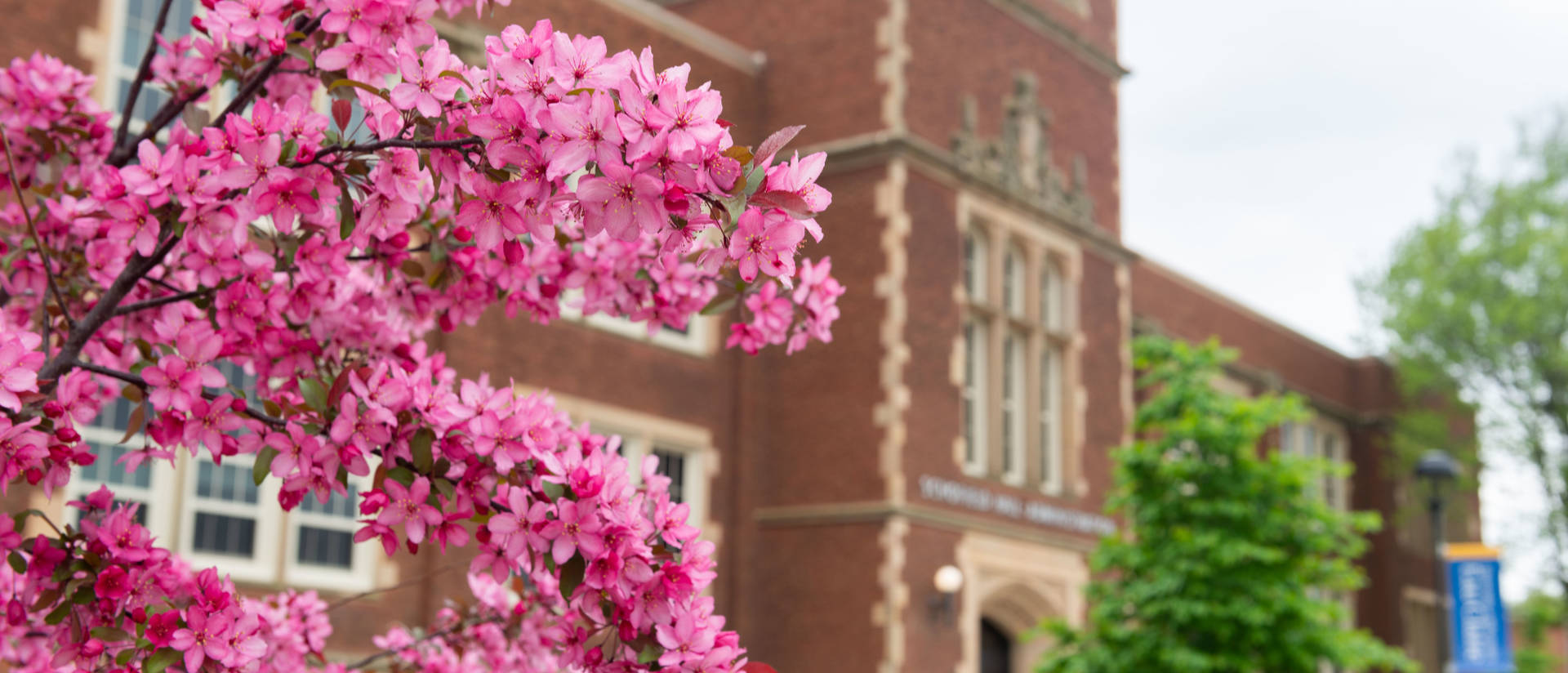 Schofield Hall in the spring with trees blooming.