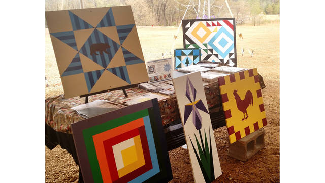 Several examples of barn quilt patterns were on display at the WoodWind Park Performance & Event Venue in Wheeler as part of their first craft fair in May. (Submitted photo)