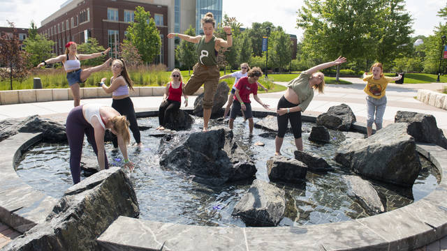 Dance students in water feature