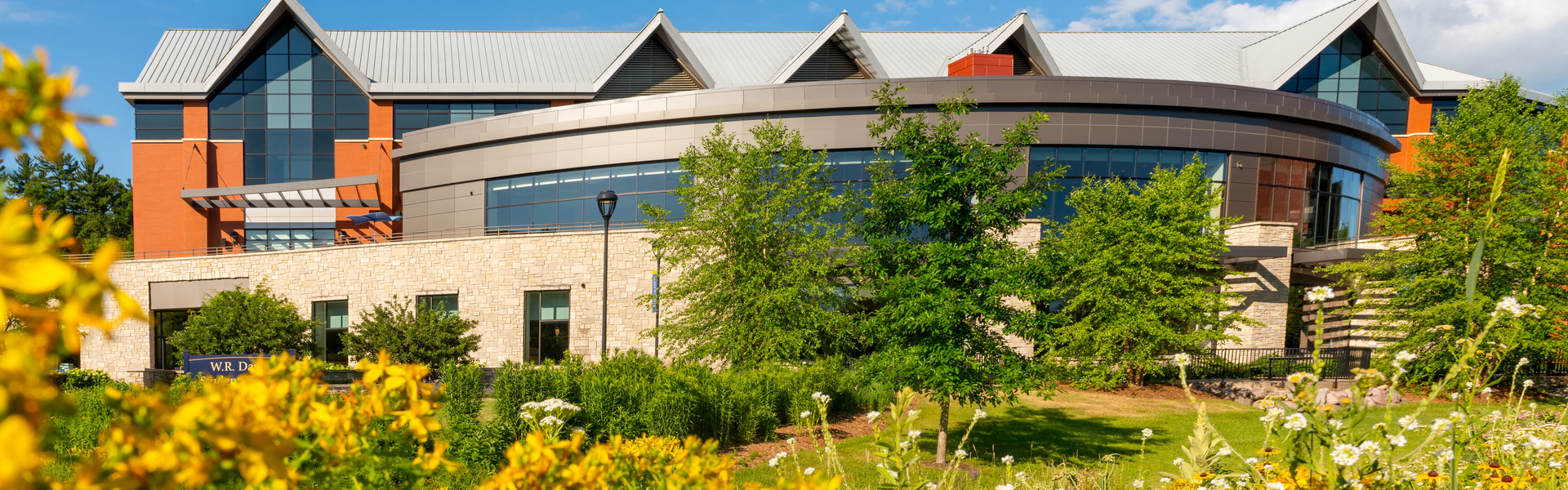 Exterior shot of Davies Student Center in the sunshine
