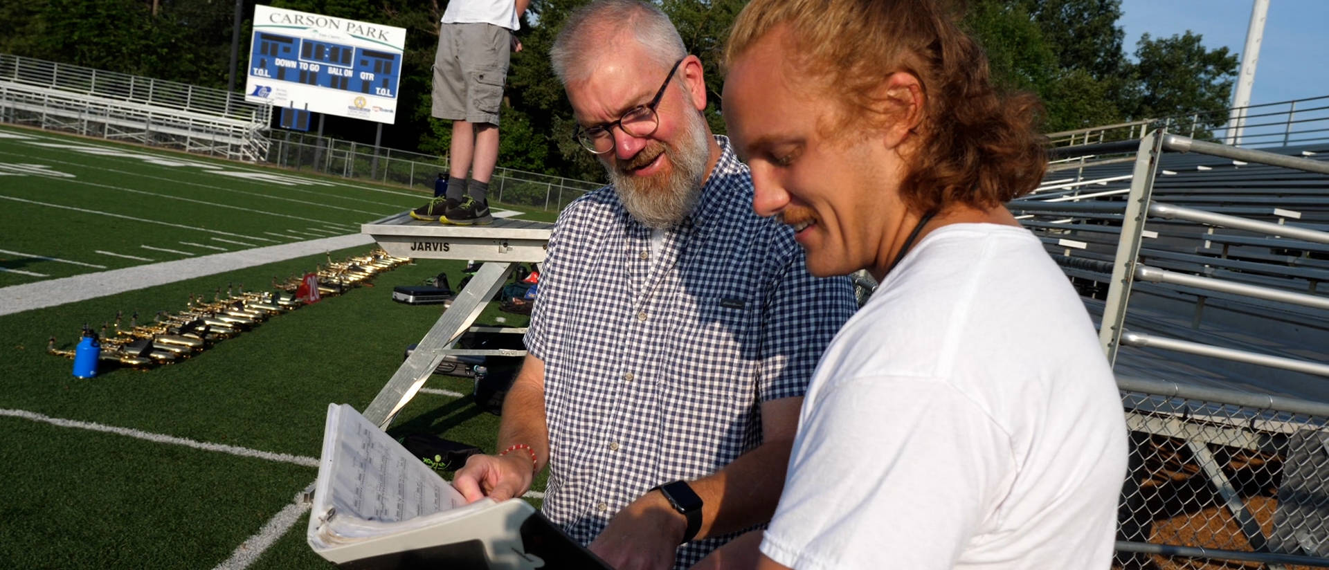 """Music professor Dr. Jeff Crowell (left) collaborated with Andrew Smits, a music education major who plays in the Blugold Marching Band, on a summer research project, """"Blugold Marching Band Formation Research Project."""""""