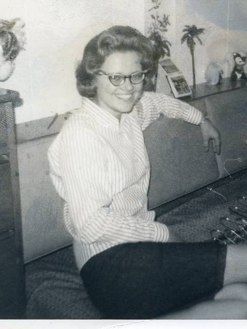 Christy (Hanson) Linderholm sits in Governors Hall in 1966, where she lived for four years. Her granddaughter, new freshman Lucy Franklin, is living on the same floor of the dorm this year.