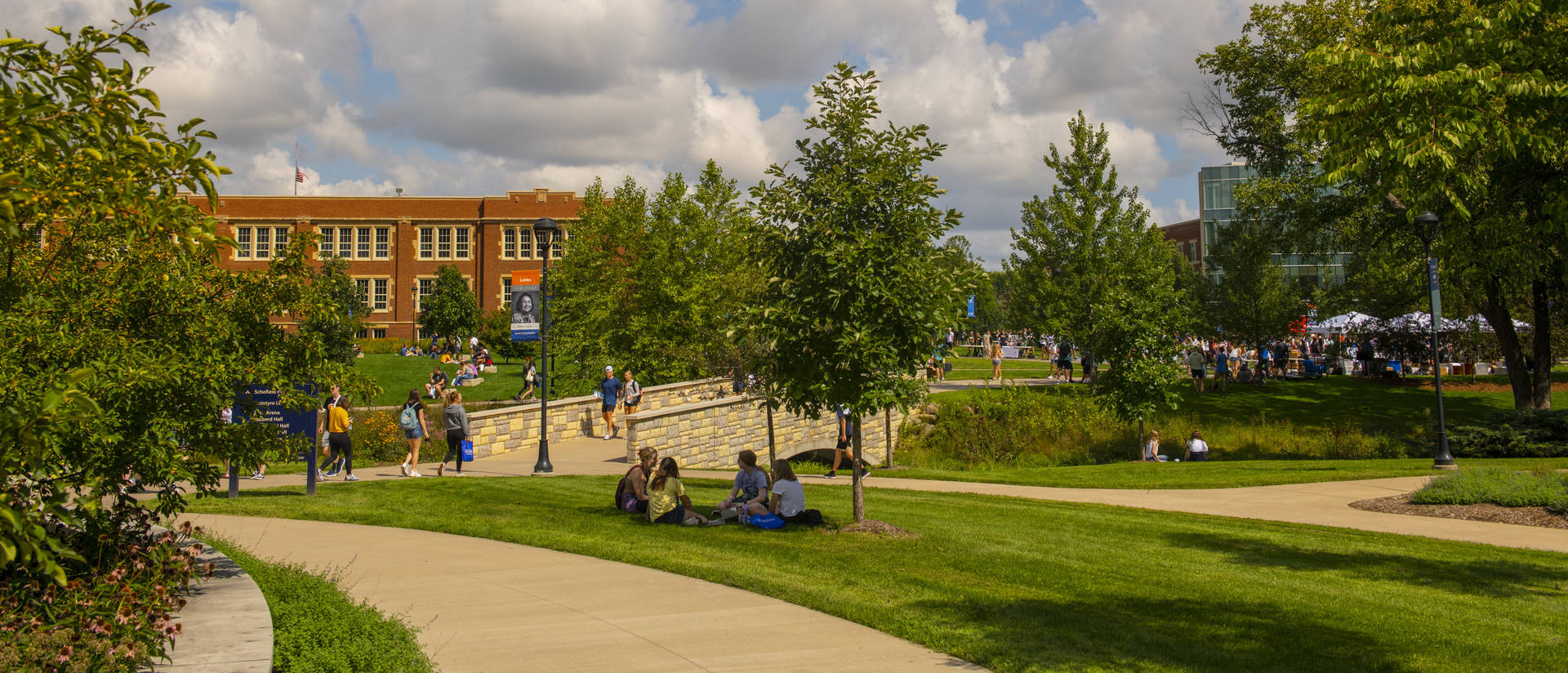 Campus mall with students in fall