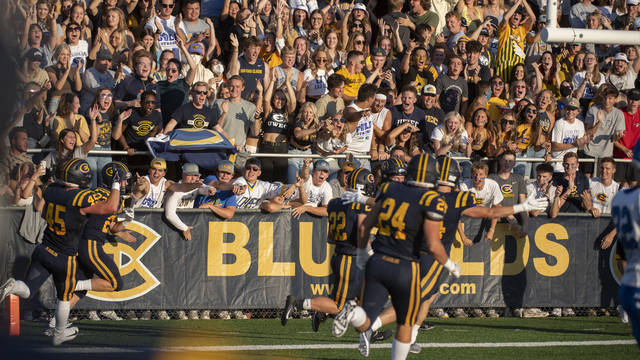 Students cheering at Blugold football game