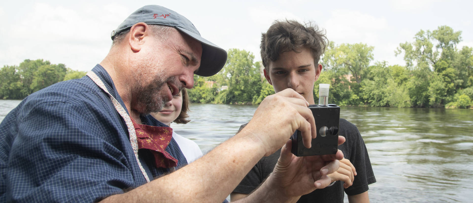 UW-Eau Claire geology professor Dr. J. Brian Mahoney shows high schooler Quinten Anger how to use a colorimetric kit to measure nitrate concentration in the Chippewa River. (Submitted photo)