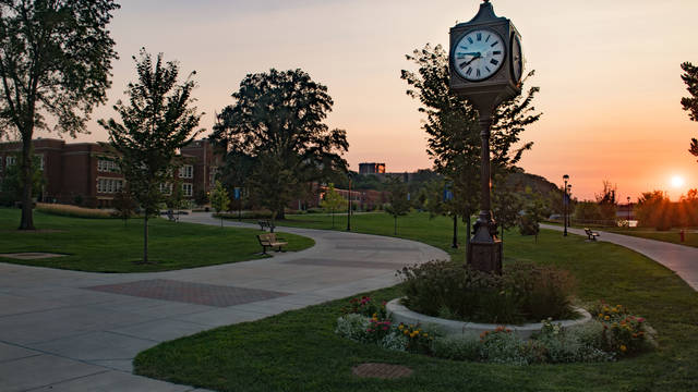 Campus beauty picture showing Schofield Hall and the clock tower.