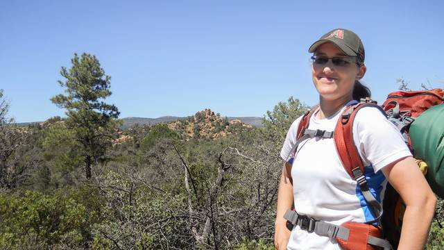 Brielle Cummings hiking in the Apache Creek Wilderness area
