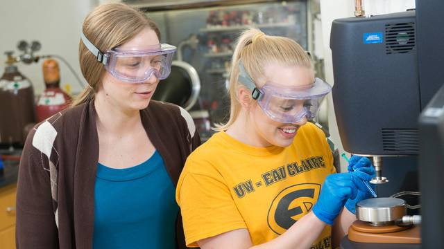 Dr. Liz Glogowski (left) works with materials science student Liz Stubbs on measuring the viscosity of polymer samples as part of the UW System Applied Research Grant project. Different viscosities of the polymers are important for enhanced oil recovery.