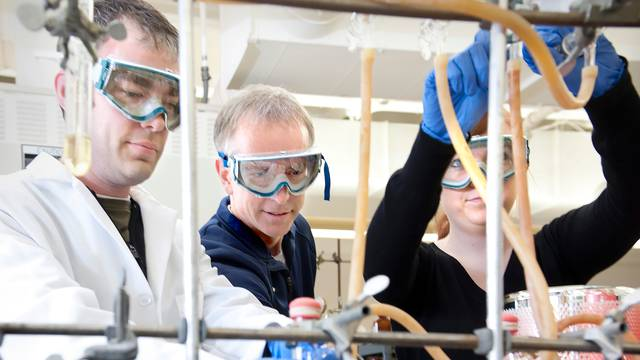 Dr. Mike Carney (center), a 1983 UW-Eau Claire graduate who now teaches at his alma mater, and his student research team are working on a project with a UW-Eau Claire graduate who now teaches chemistry at Northland College.  Three generations of Blugolds